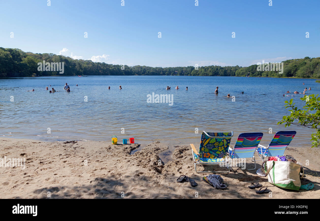 Crystal Lake swimmers in Orleans, Massachusetts. - Stock Image