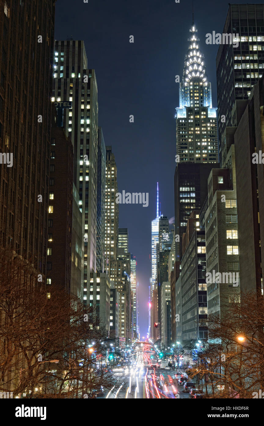 NYC streets at night. Midtown Manhattan - 42nd Street with Chrysler Building. - Stock Image