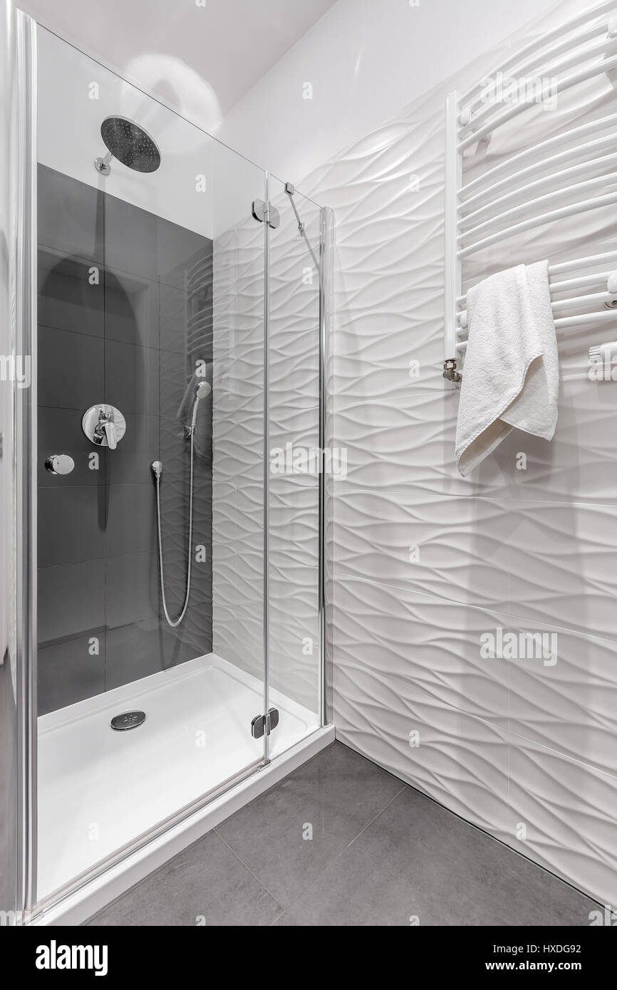 Luxury bathroom in apartment with big shower and patterned white ...