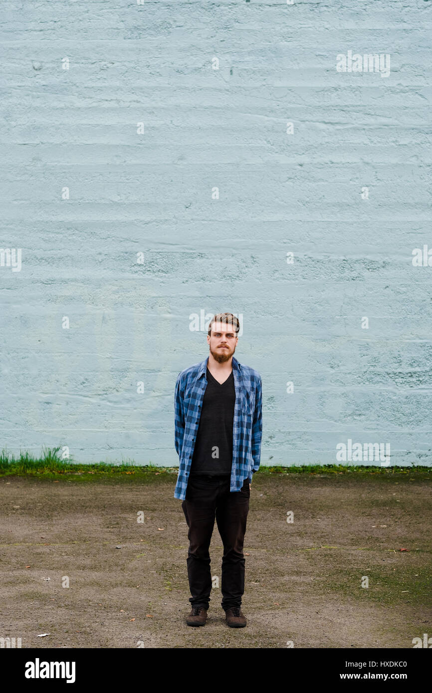 Hipster Posing Outdoors For The Camera With A Fashion Forward Style And Modern Man Appearance