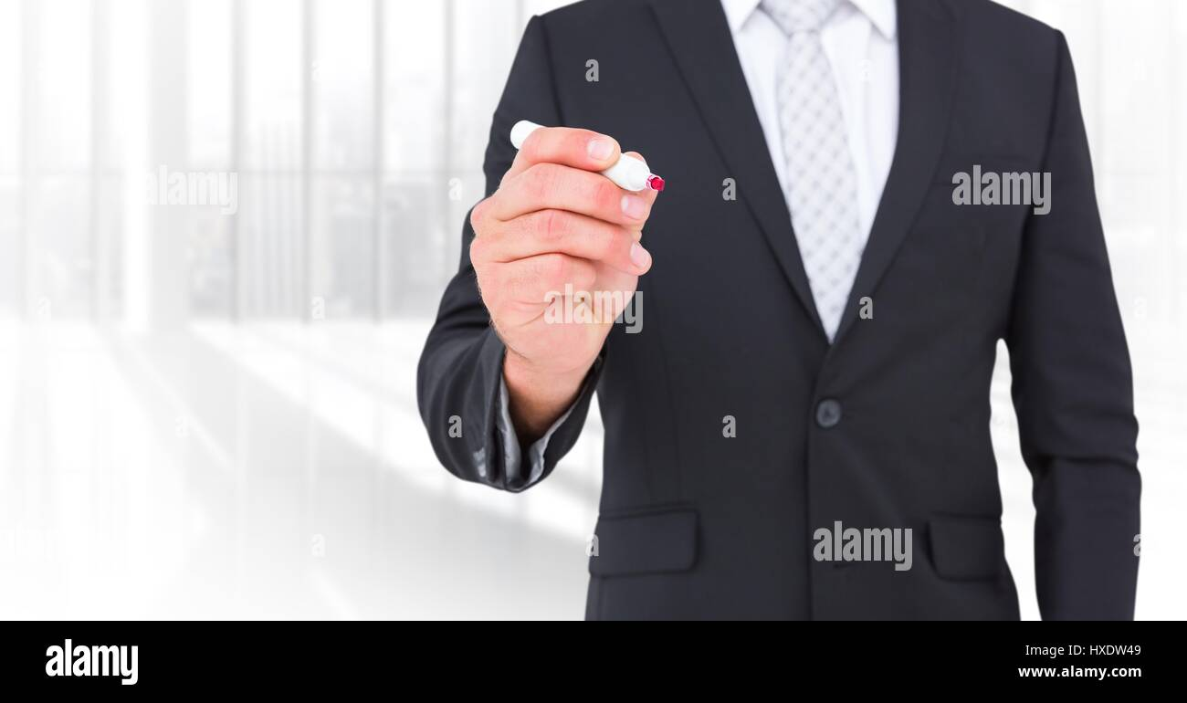 Digital composite of Business man mid sections with pen against blurry window - Stock Image