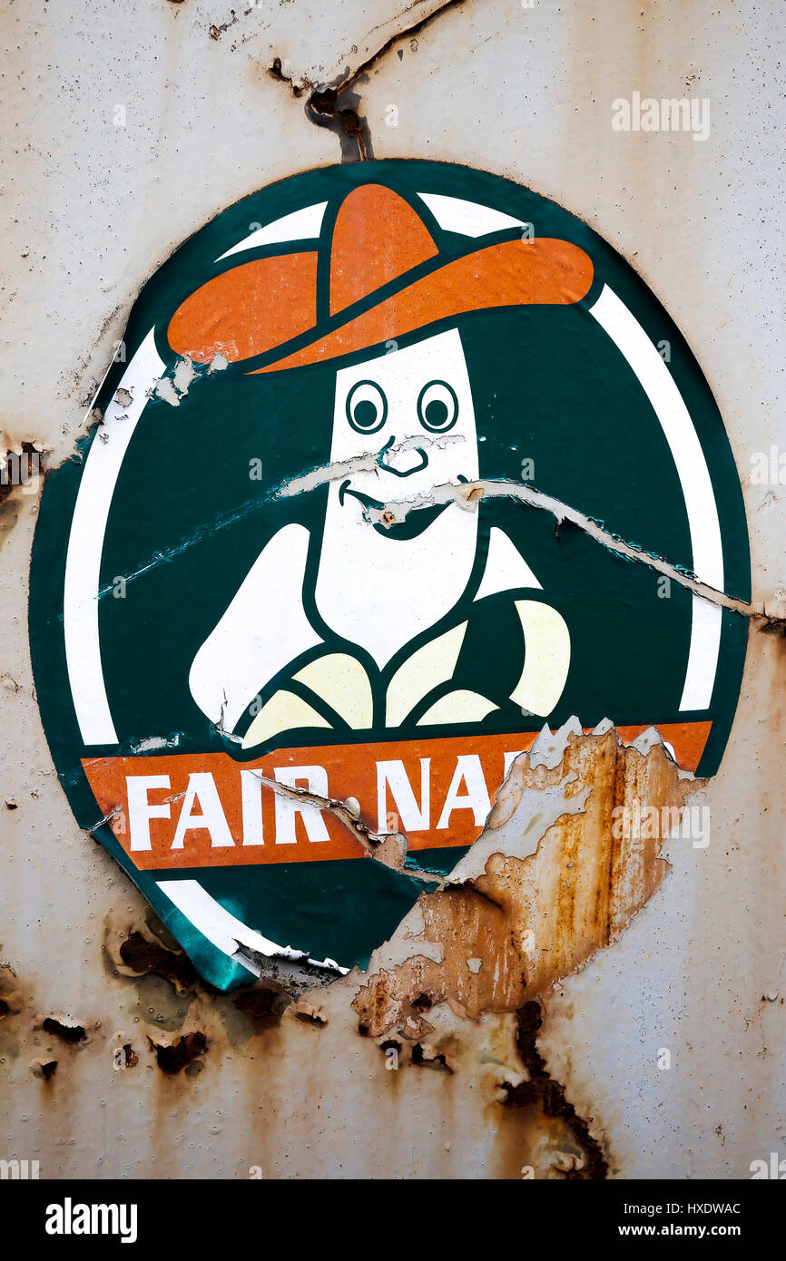 An old and damaged sticker with a banana and Sombrero in a crane in the harbour, In old and damaged embroiderer - Stock Image