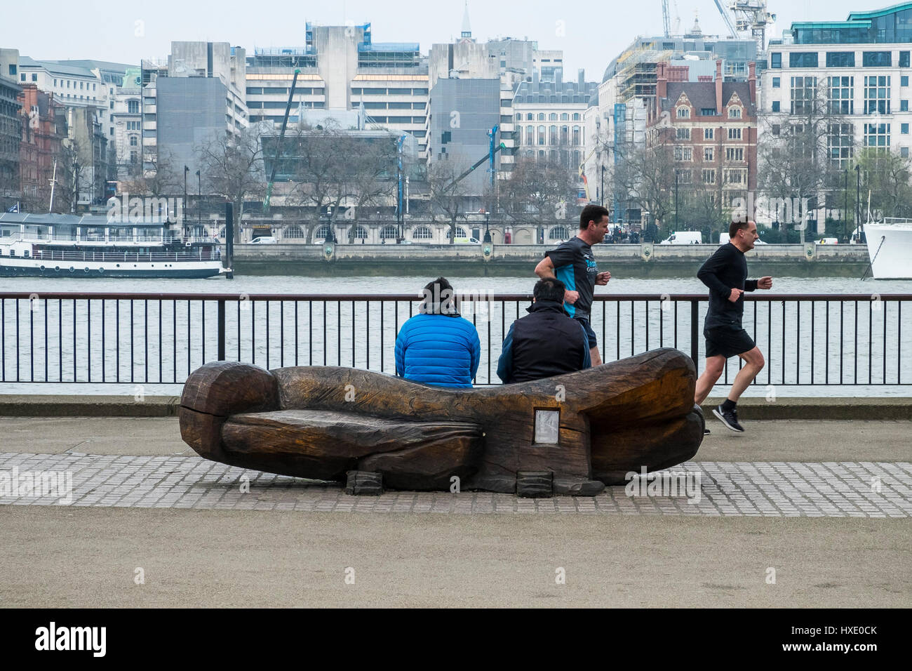 Southbank South Bank Seat People Sitting Running Runners Jogging Joggers Exercise Healthy lifestyle Leisure River - Stock Image