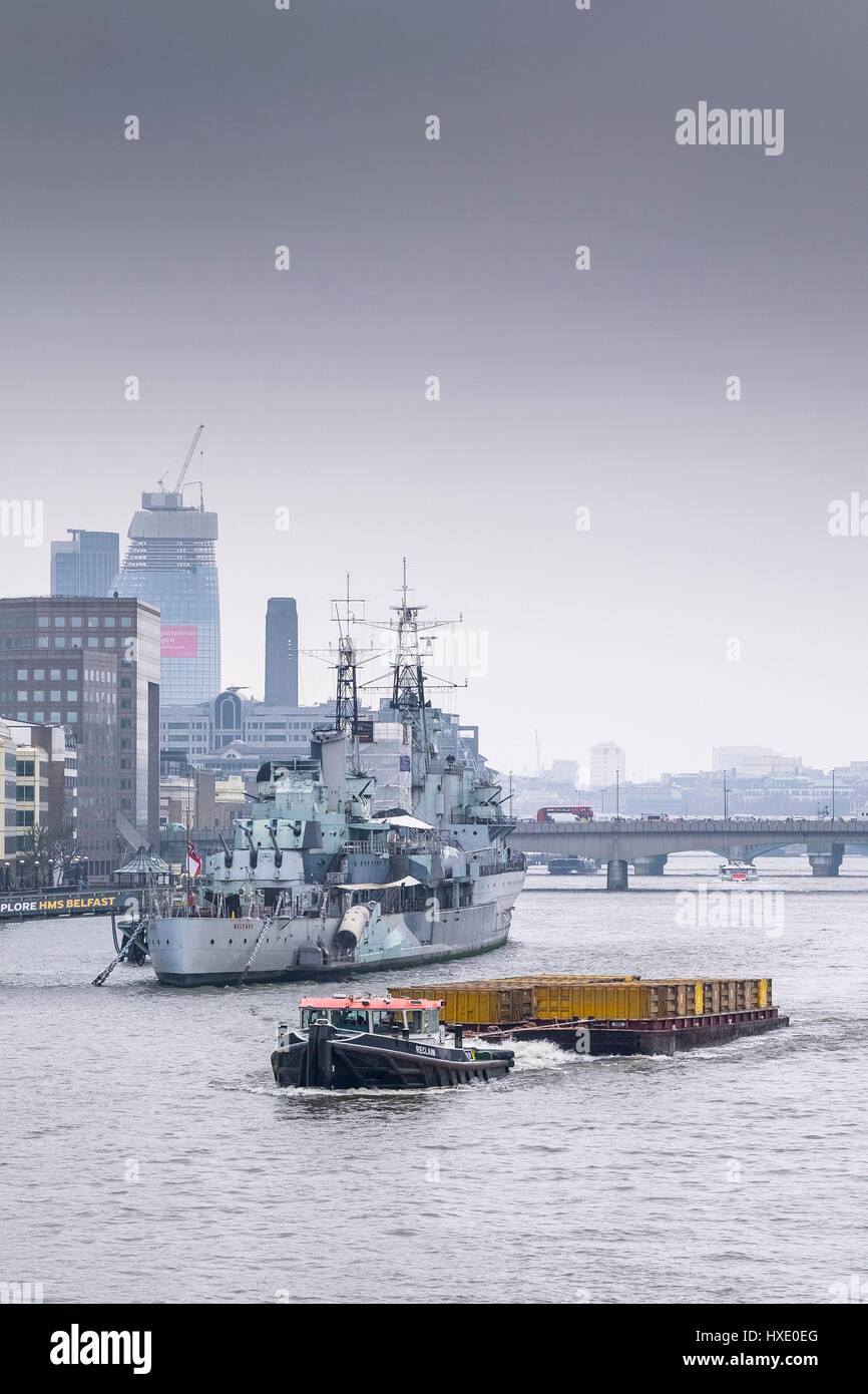 Tug Regain River Thames Towing Barges Lighters Lighterage Vessel Waste Collection HMS Belfast - Stock Image