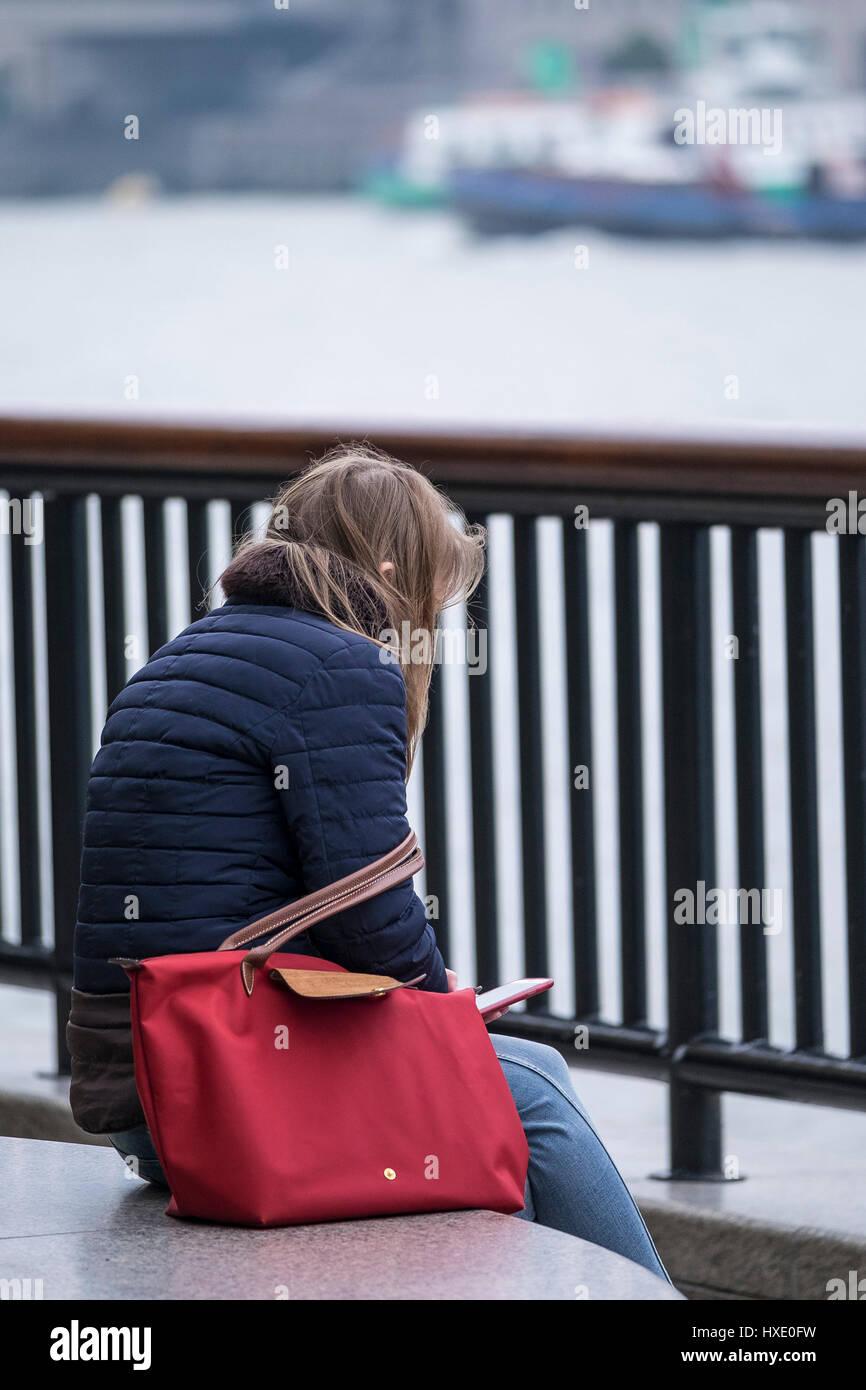 Girl Teenager Sitting Alone Isolated Isolation - Stock Image