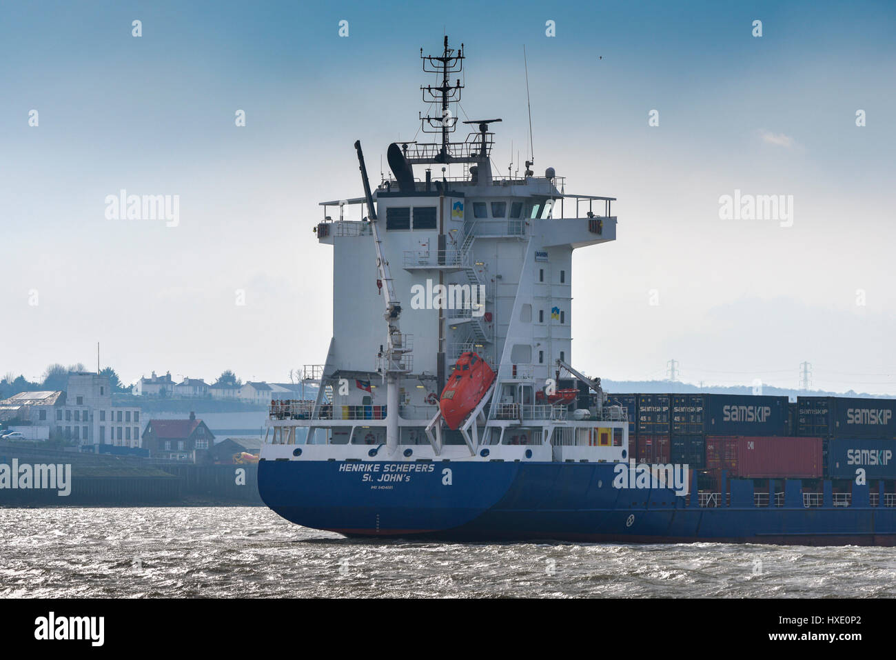 The container ship Henrike Schepers steaming upriver on the River Thames in the UK. Stock Photo