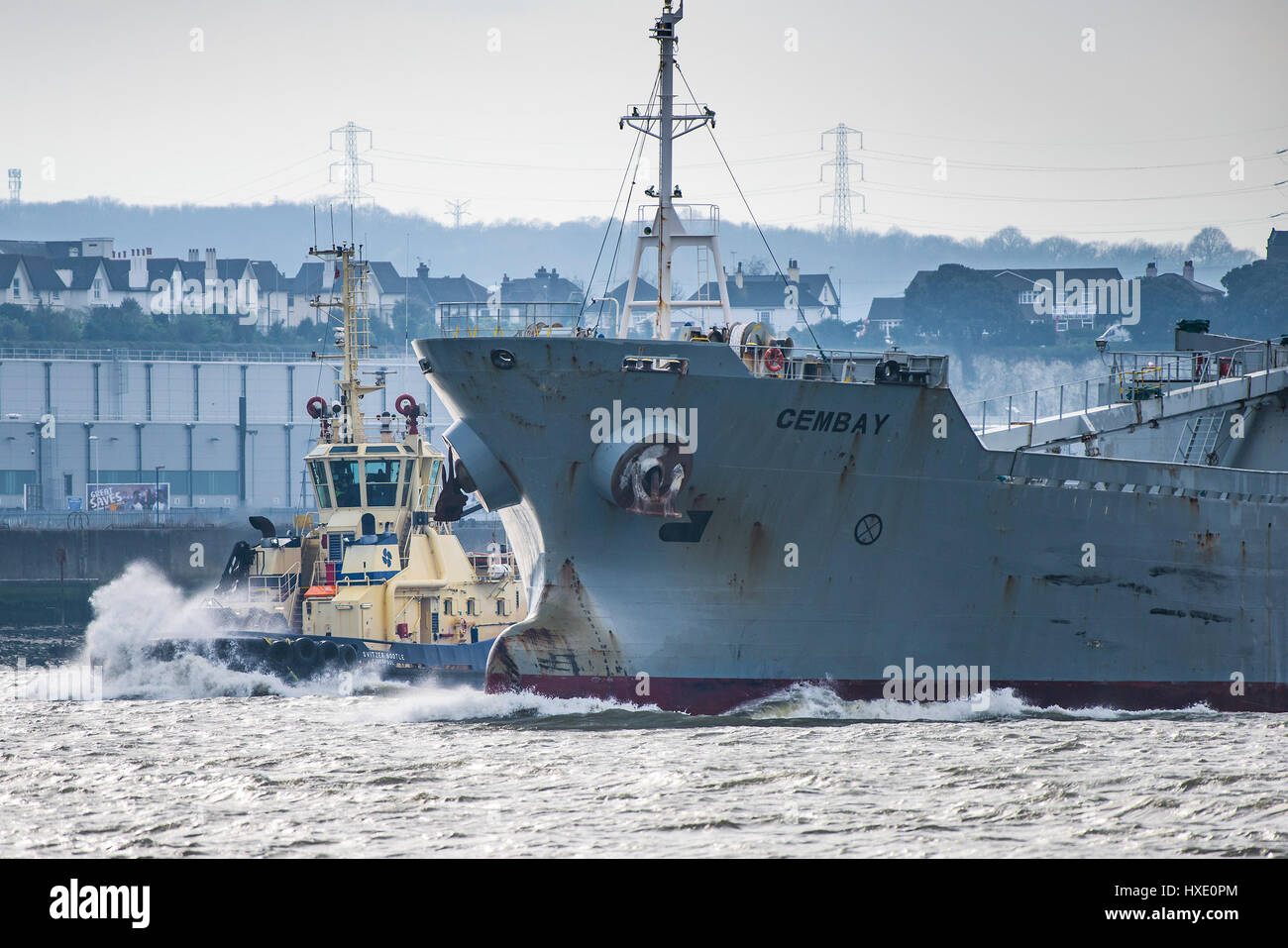Ships Shipping Tug Vessels Svitzer Bootle Assisting Cembay Cement Carrier River Thames Steaming Downriver Transport - Stock Image