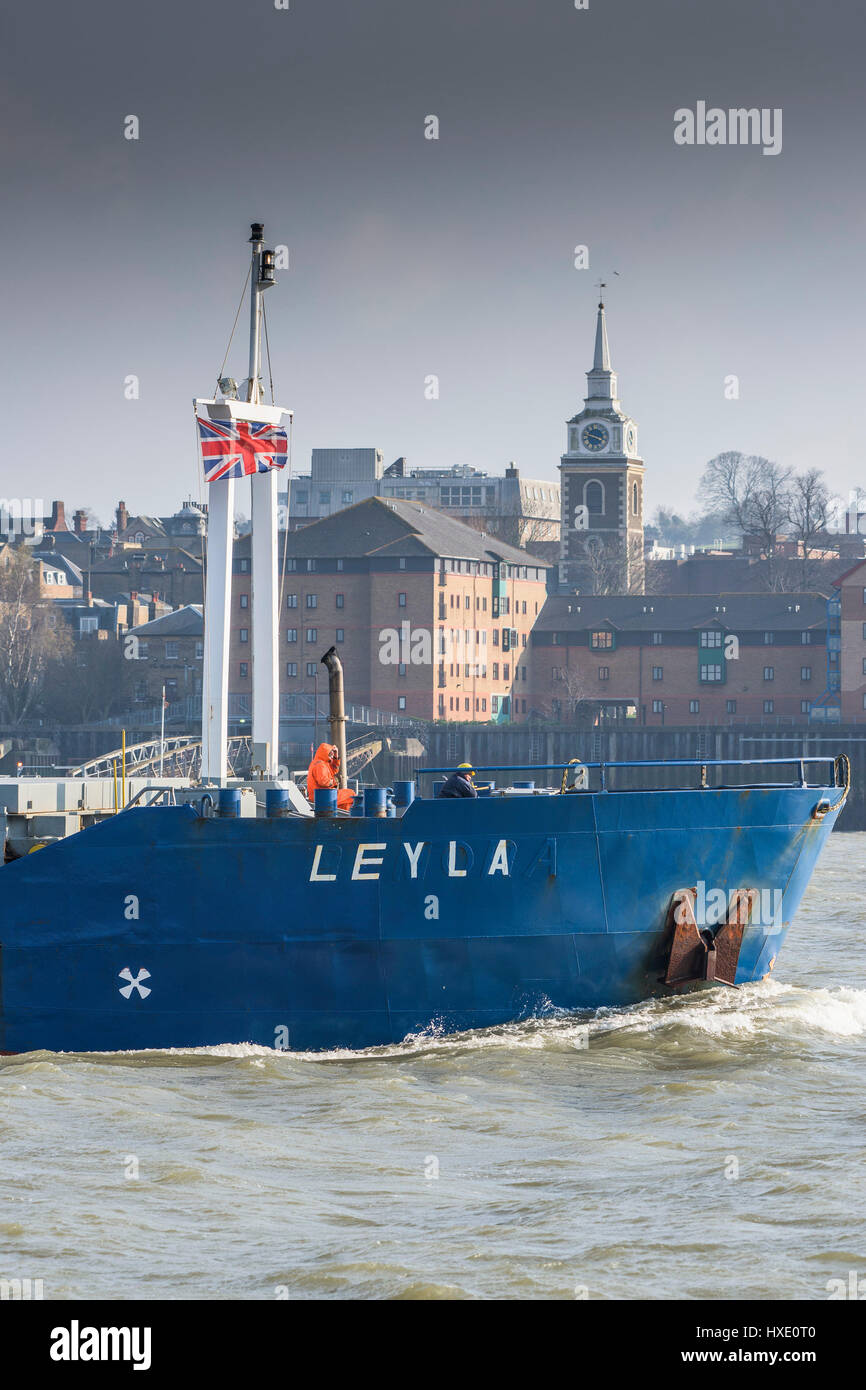The general cargo ship LAYLA steaming upriver on the River Thames in the UK. - Stock Image