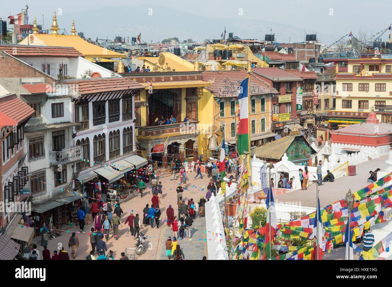 Kathmandu, Nepal - 18 March 2015: People are walking around Boudhanath temple in Kathmandu - Stock Image