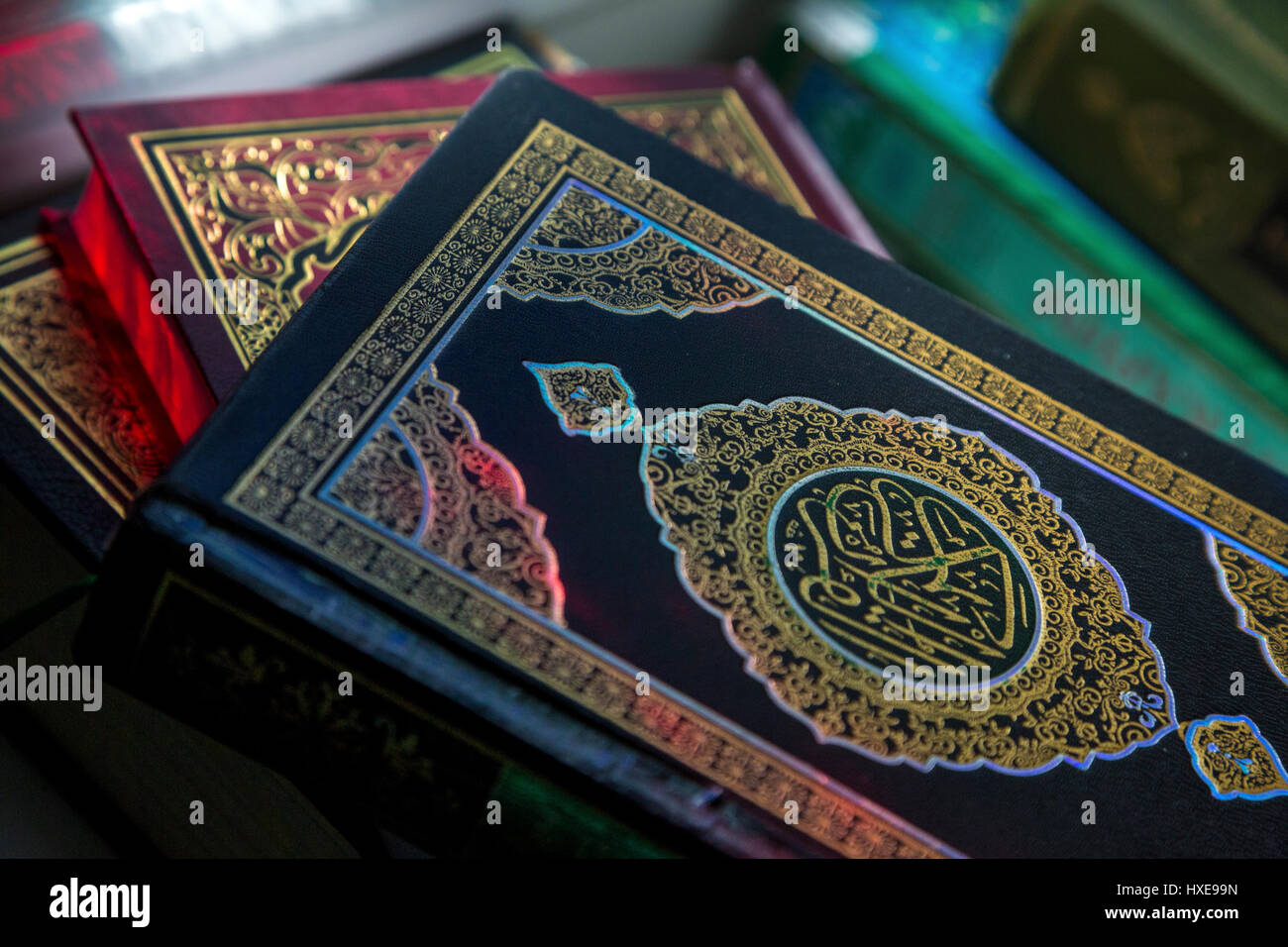 The holy book of Muslims - the Koran is on the stand in the mosque during the prayer - Stock Image