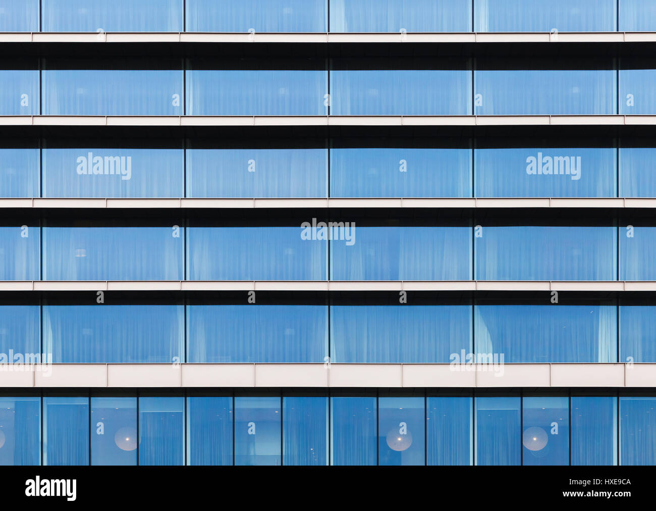 Modern building facade, wall made of blue glass, steel frames and ...