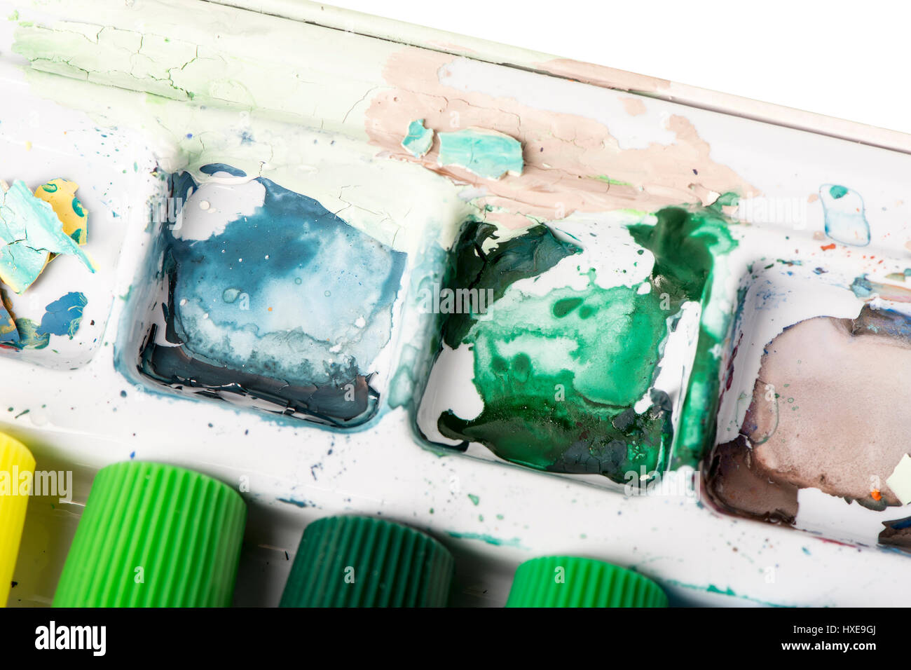 A used oil paint palette with dried paint in cool colors. - Stock Image