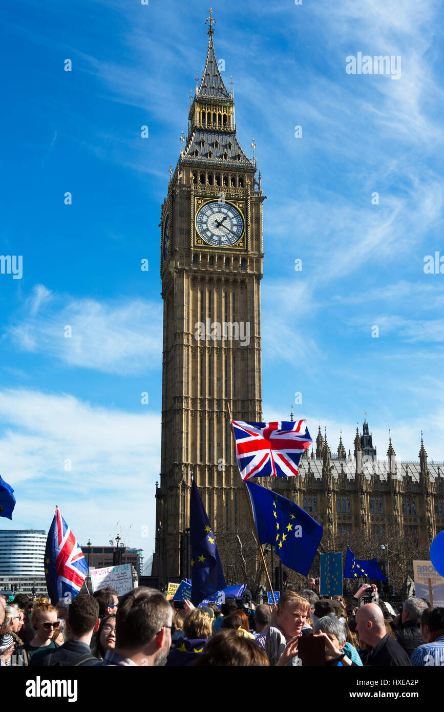 'Unite for Europe' marchers fly the Union and EU flags in Parliament Square, London, UK - Stock Image