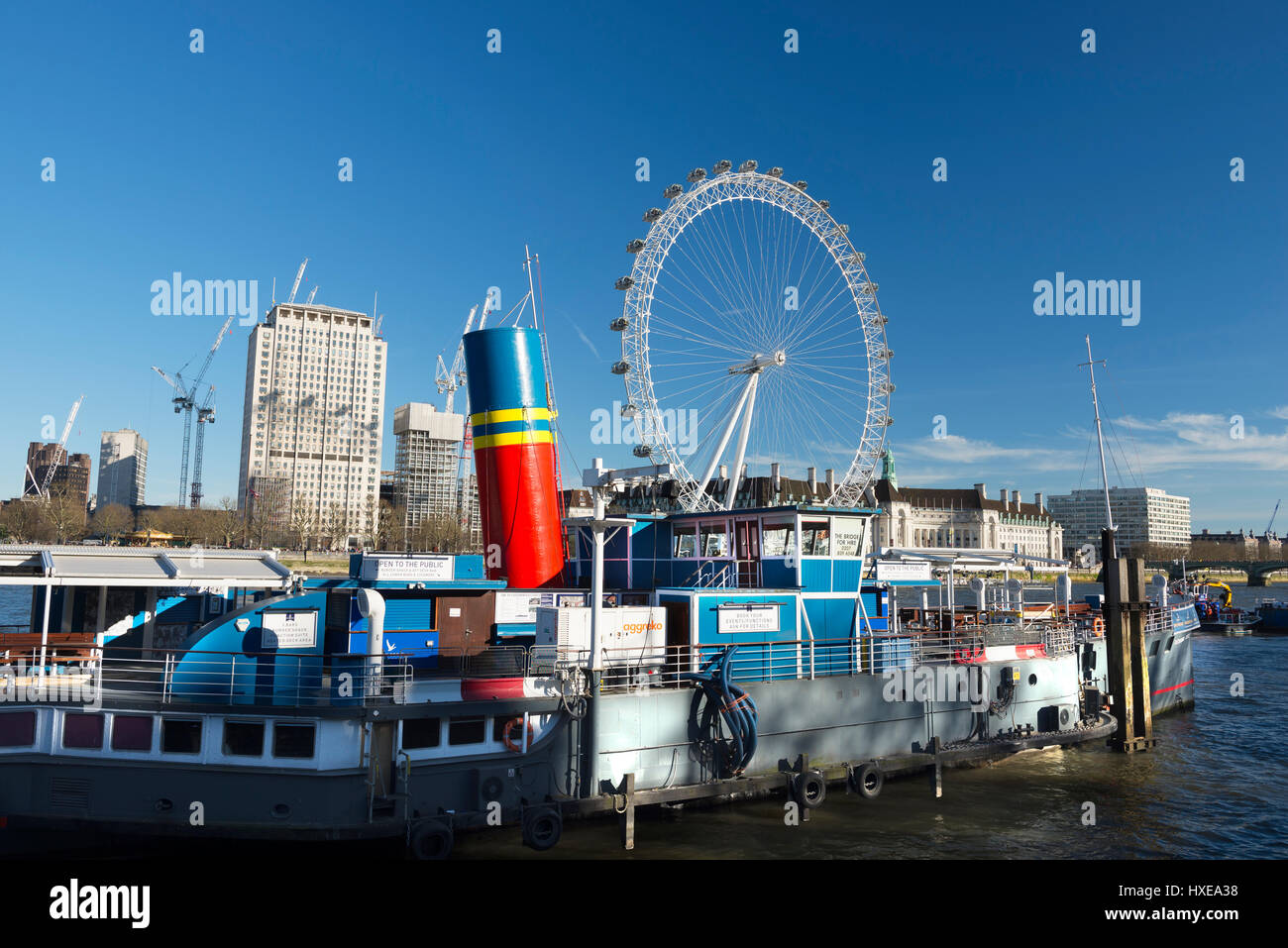 The PS Tattershall Castle restaurant boat on the River Thames with the London Eye and County Hall behind, London, Stock Photo