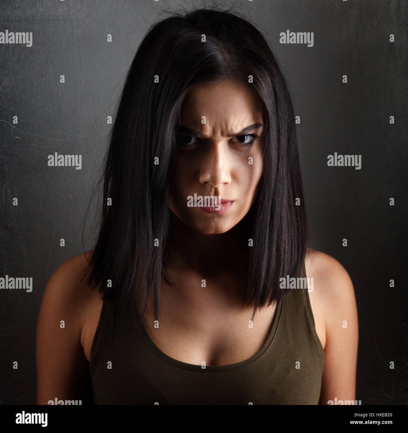 Portrait of angry evil dark woman - Stock Image