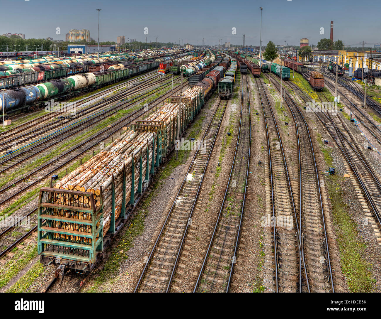 St. Petersburg, Russia - May 22, 2015: Freight trains ready to depart for shunting yard. Many wagons and railway - Stock Image