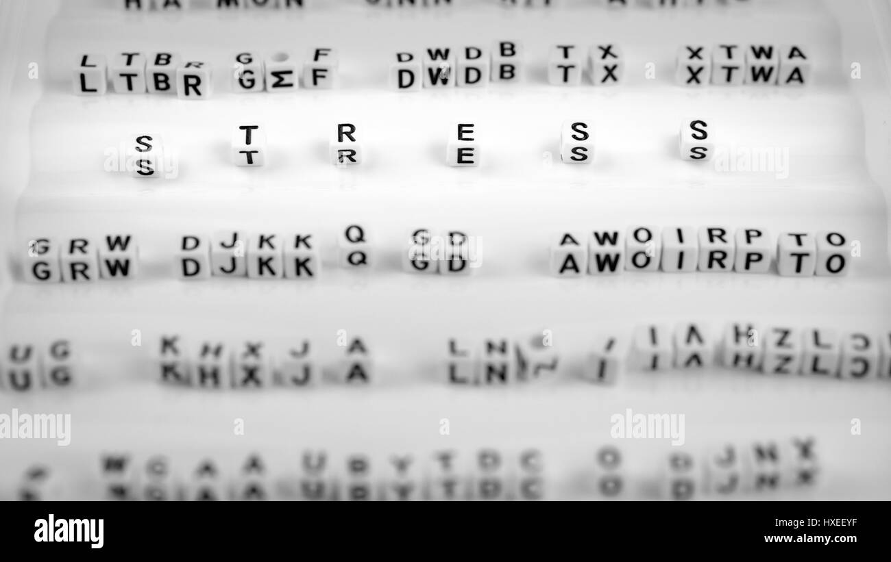 Stress letters between other blurred lettters, black and white - Stock Image