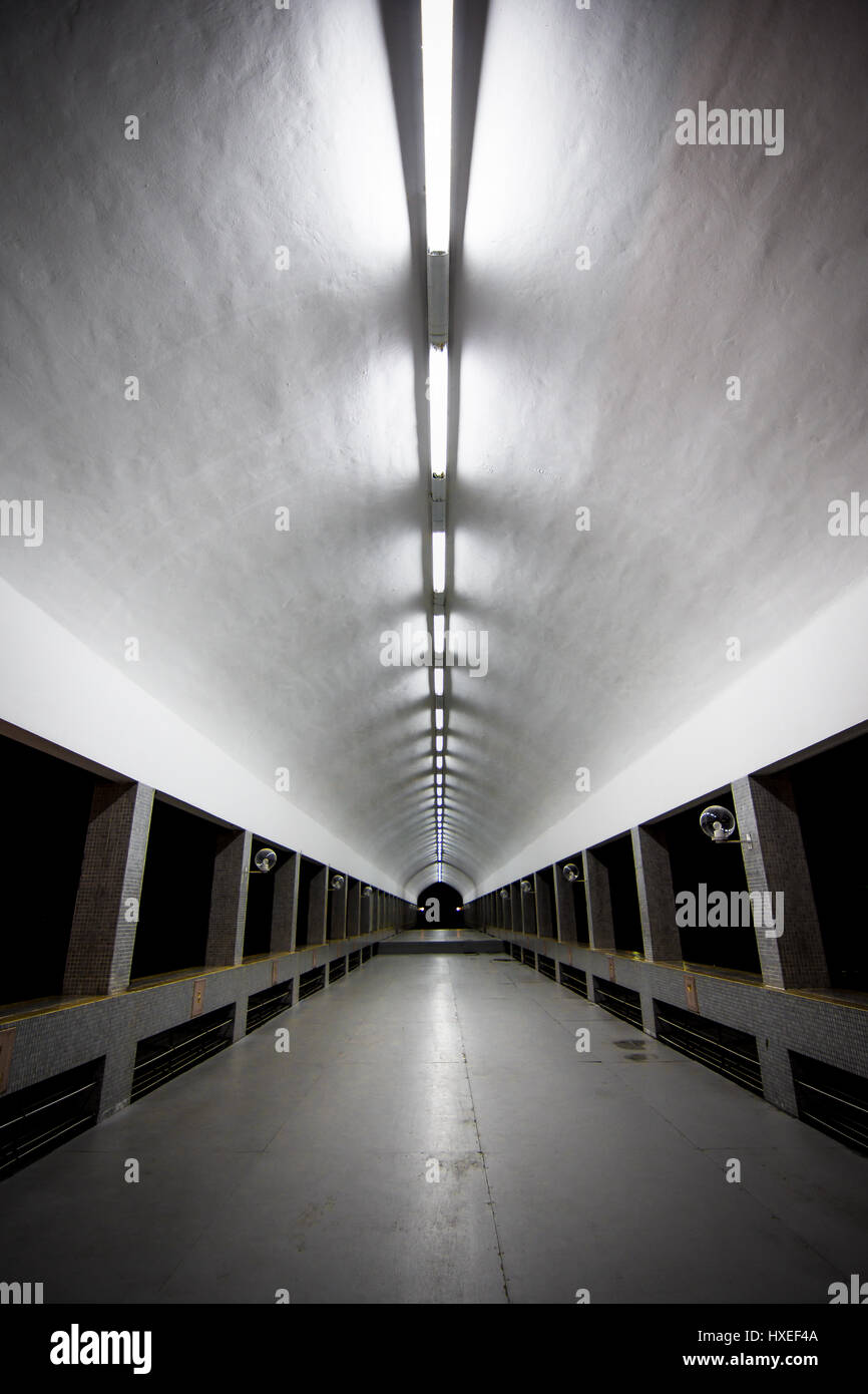 A long covered illuminated walk way tunnel leading away from Brunei's largest mosque. The Jame Asr Hassanil - Stock Image
