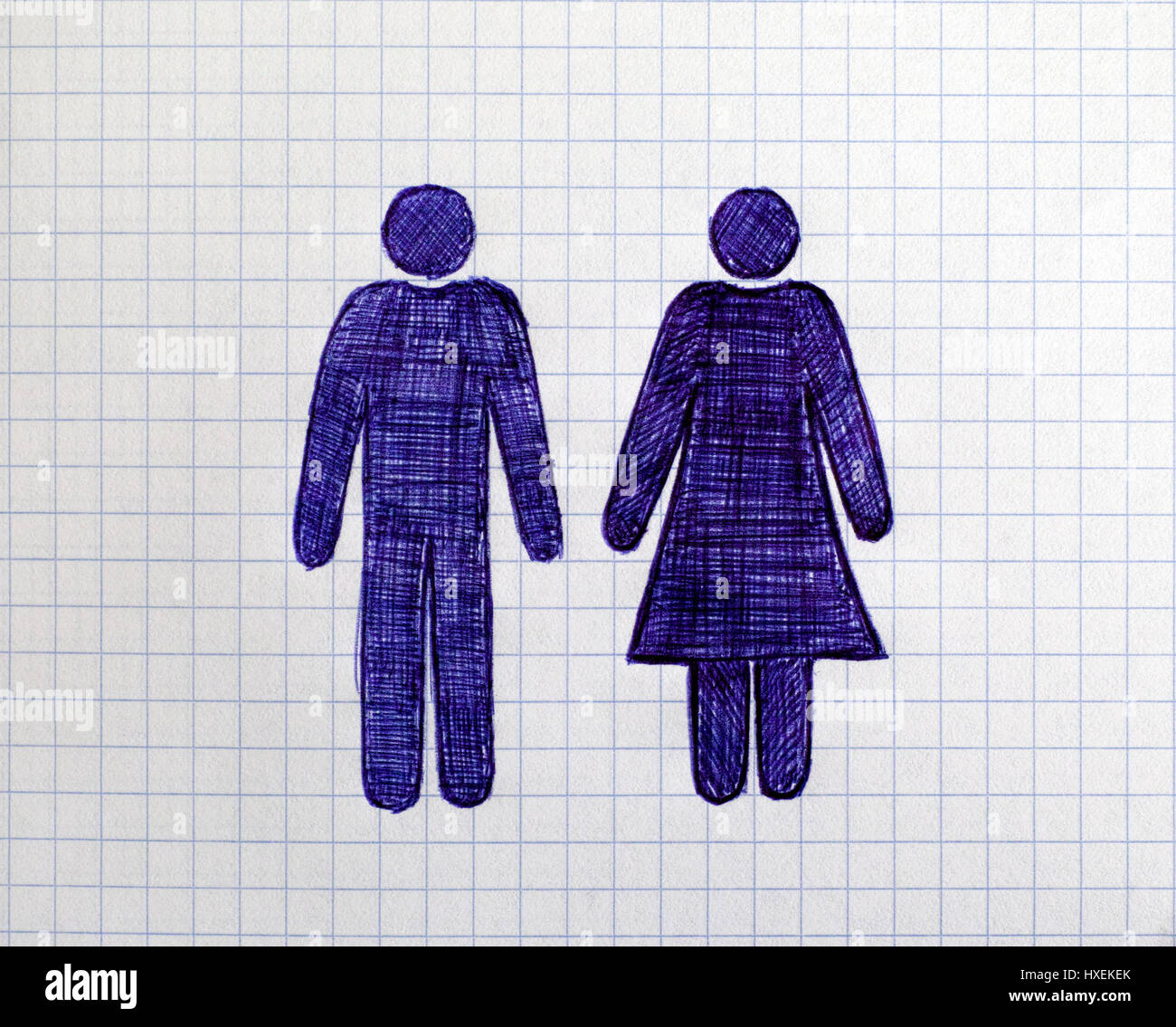 Hand drawn man and woman figures on the sheet of checkered paper. Doodle style. - Stock Image