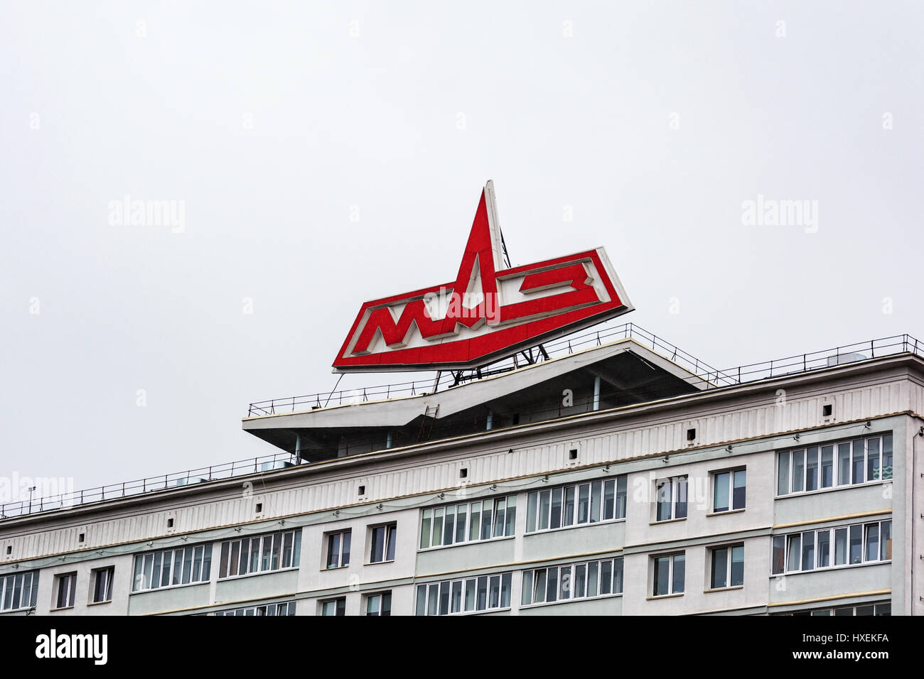 The emblem of the Minsk Automobile Plant on the roof of a residential building - Stock Image