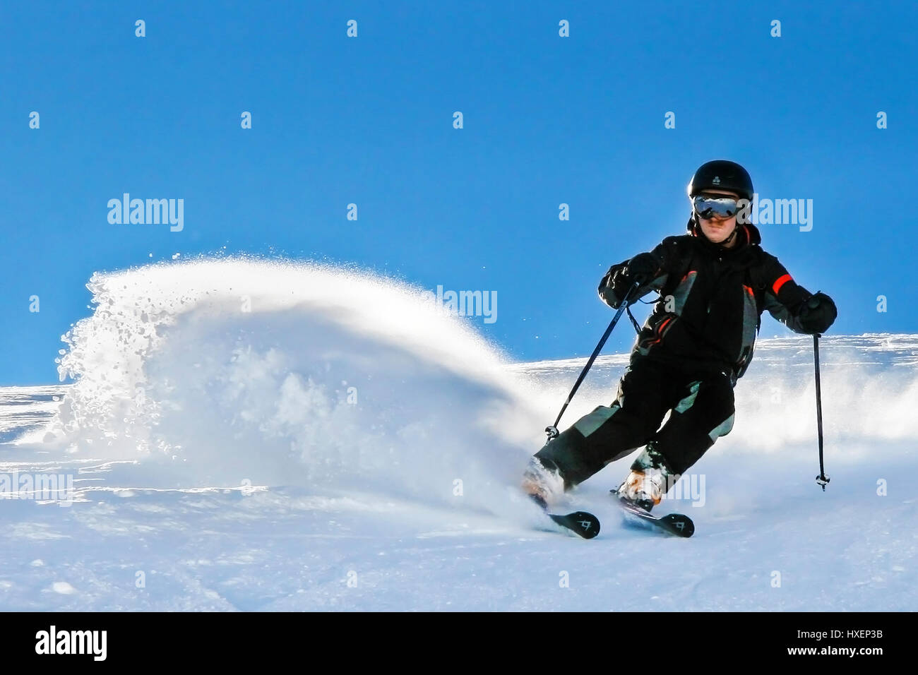 Skier enjoying the fine winter weather and great skiing conditions in Solden, Austria - Stock Image