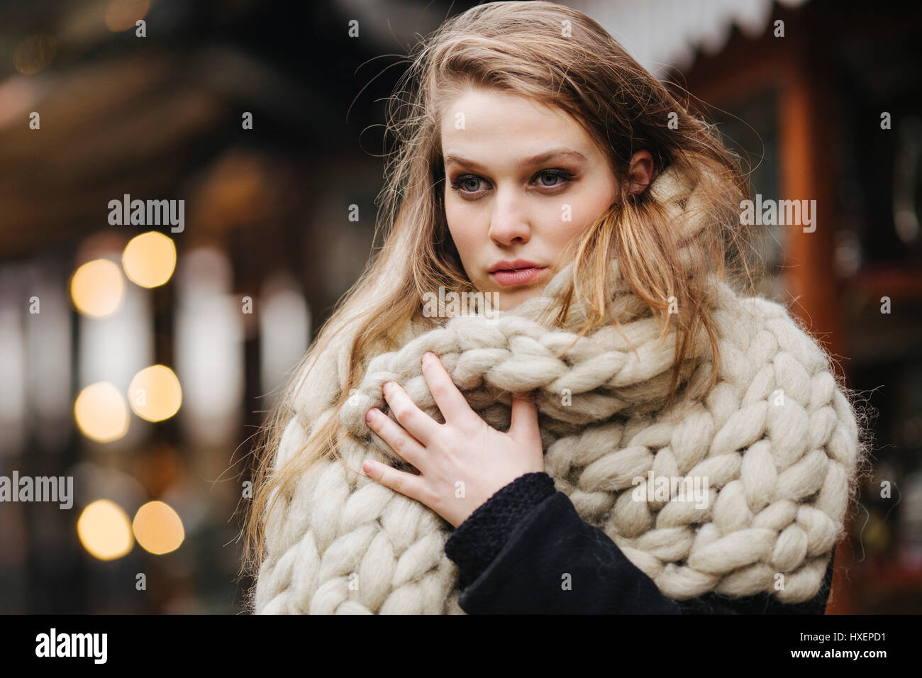 Girl with wool scarf - Stock Image