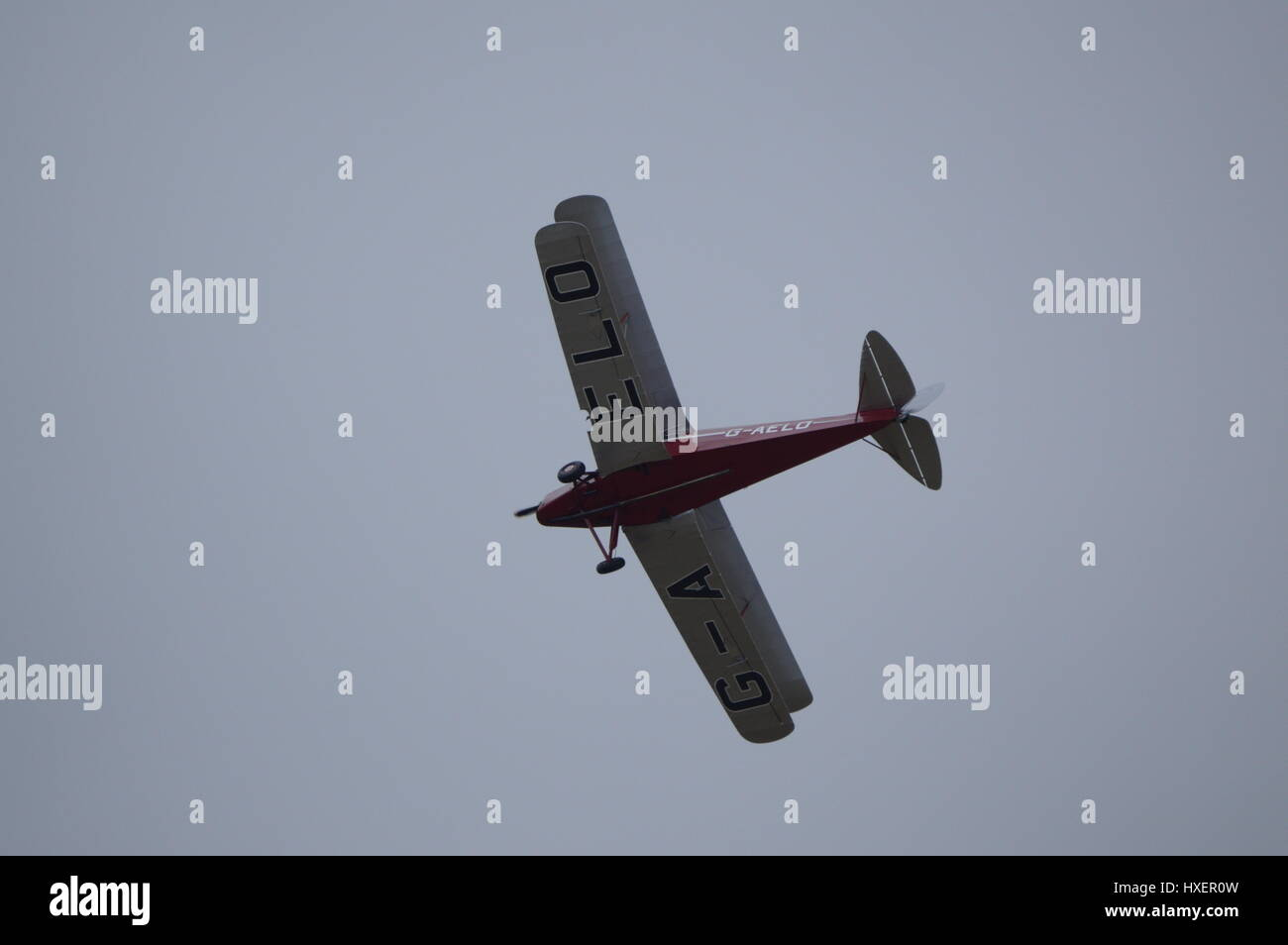 Light aircraft flying over Stow Maries Aerodrome - Stock Image