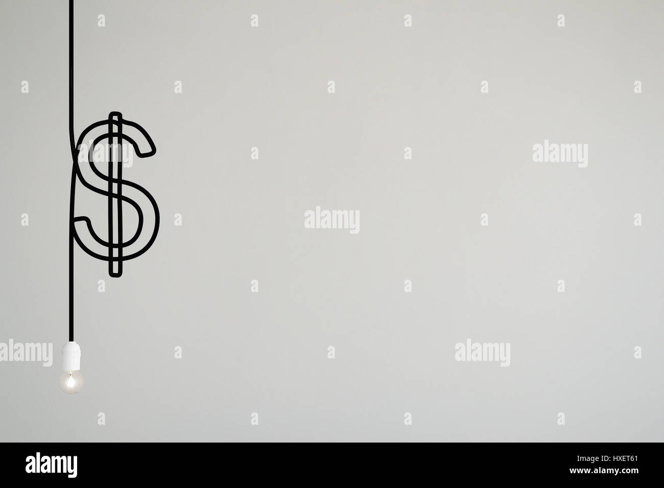 A lamps's electrical cable draws a dollar symbol - Stock Image