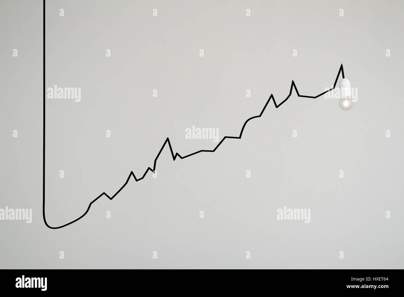 A lamps\'s electrical cable draws a rising chart Stock Photo ...