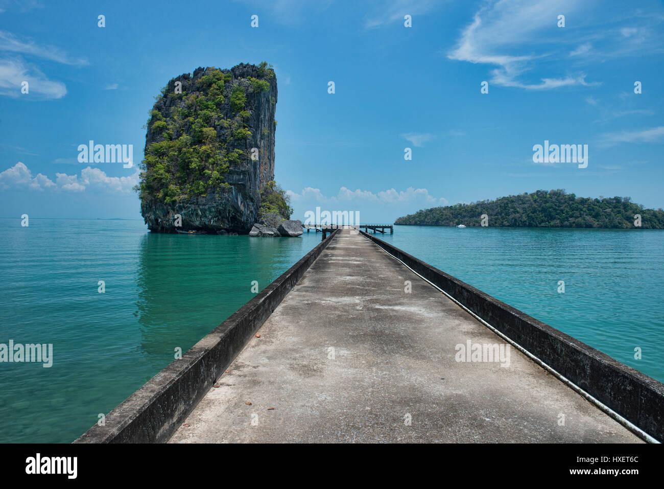 Nail rock and bridge at Ta Lo Wow, Ko Tarutao Island, Thailand - Stock Image