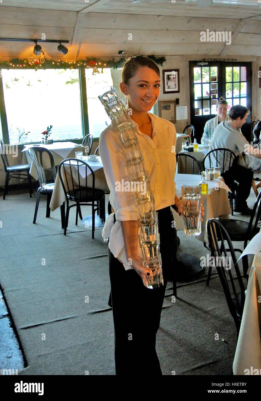 waitress restaurant carrying glasses Stock Photo