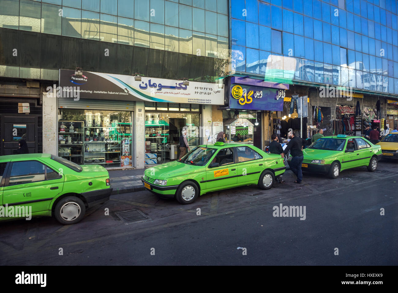 Green taxi cars in Tehran city, capital of Iran and Tehran Province - Stock Image