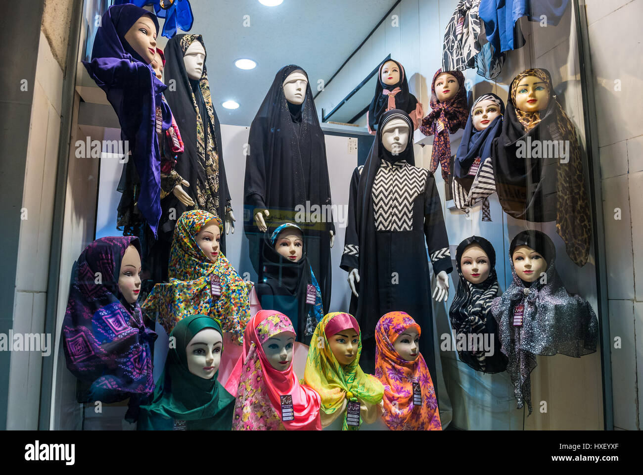 Hijabs and chadors for sale in clothes shop Isfahan, capital of Isfahan Province in Iran - Stock Image