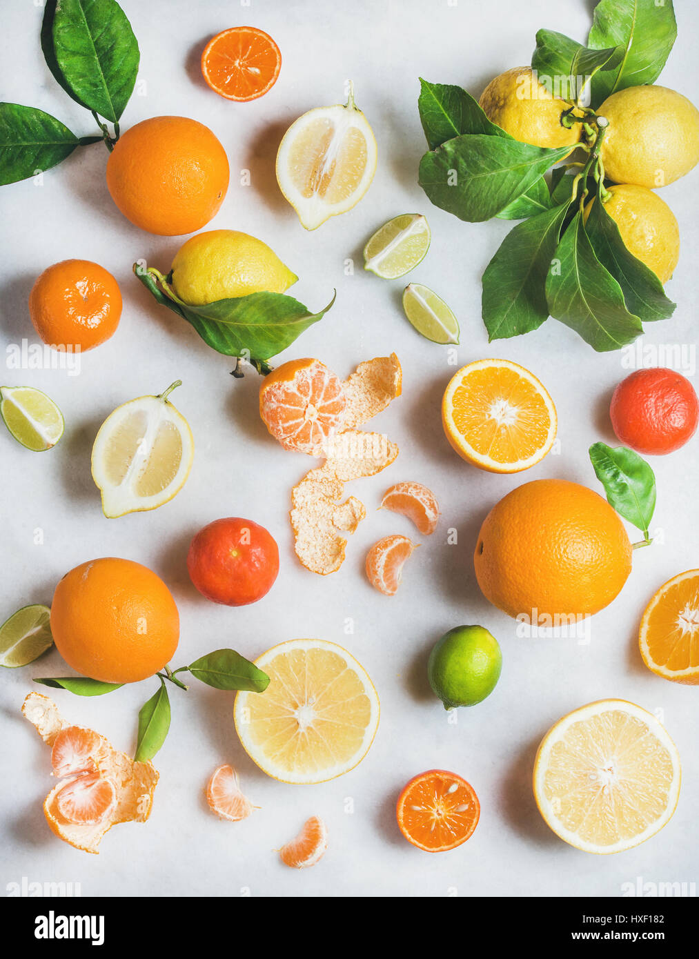 Variety of fresh citrus fruit for making healthy smoothie - Stock Image