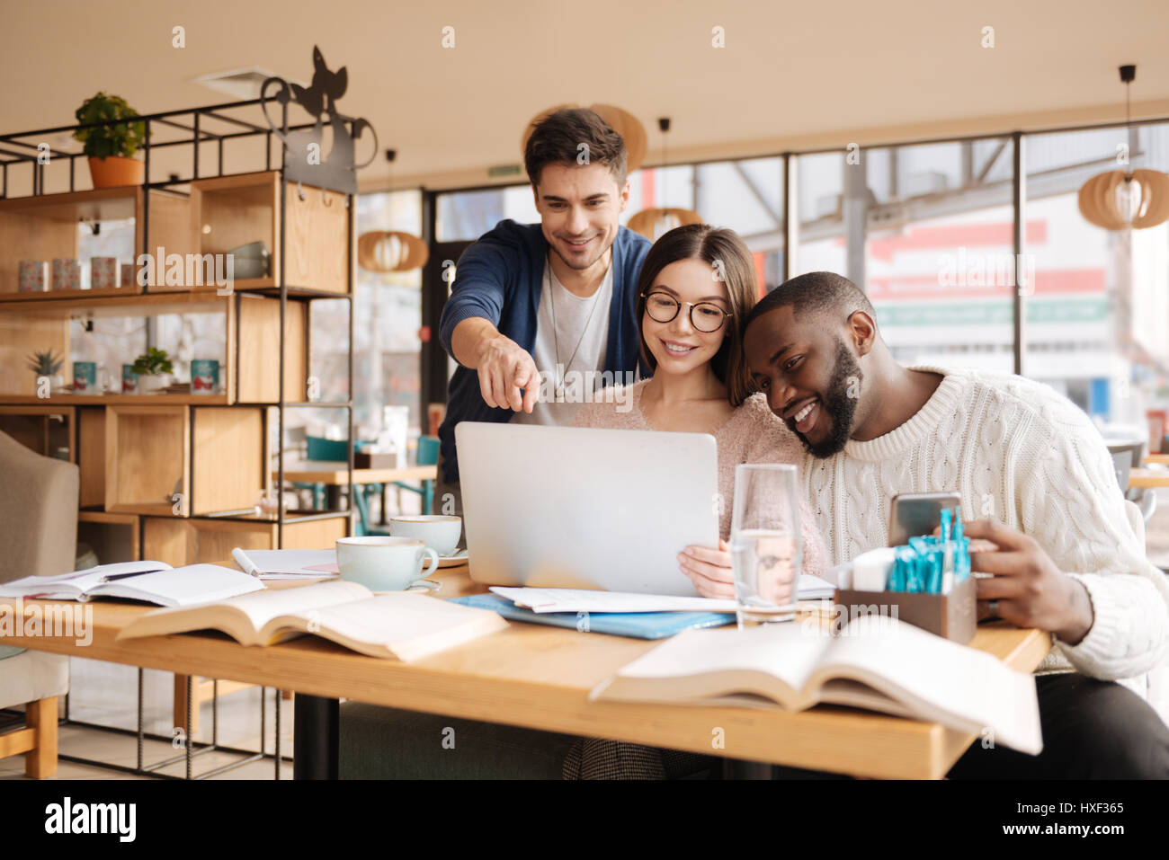 Positive students working on the project together - Stock Image