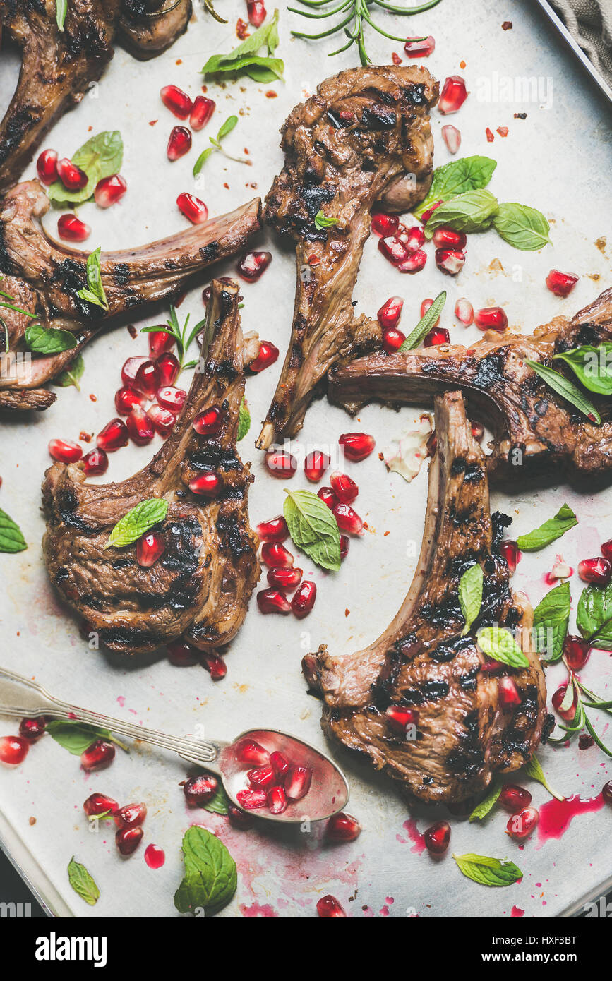 Lamb meat ribs barbecue with pomegranate seeds and herbs - Stock Image