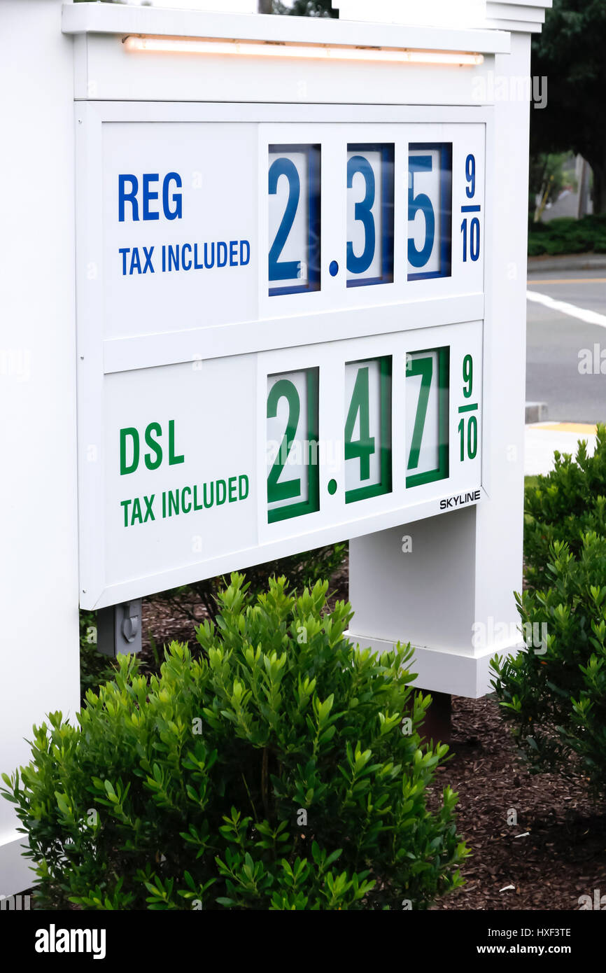 Low gasoline prices on a gas station sign. - Stock Image