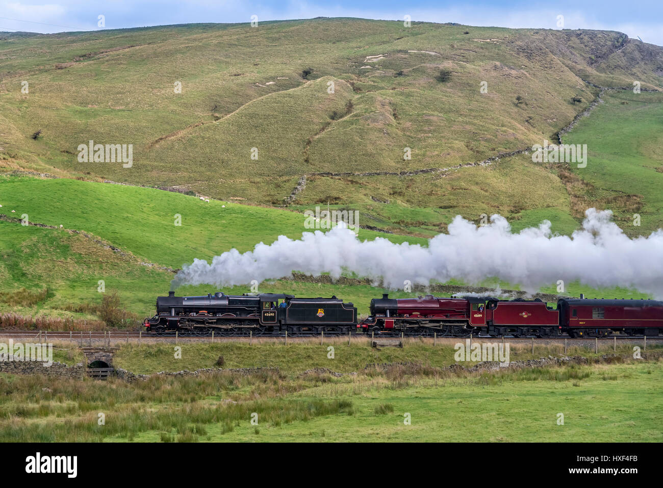 Two Jubilee Class steam engines 45690 'Leander' and 45699 'Galatea' running together on their light - Stock Image