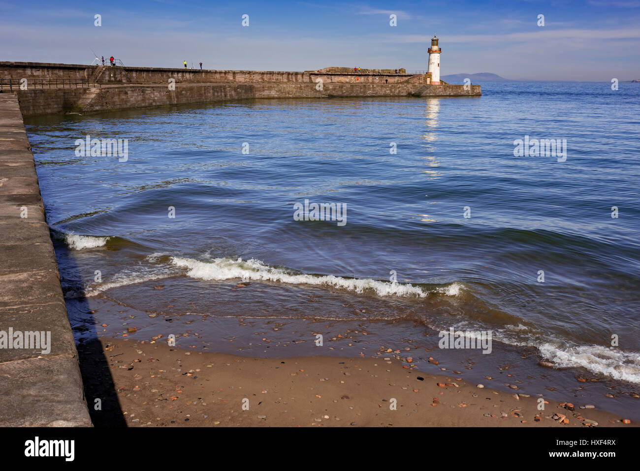 Whitehaven lighthouse on the end of the harbour wall. Cumbria. - Stock Image