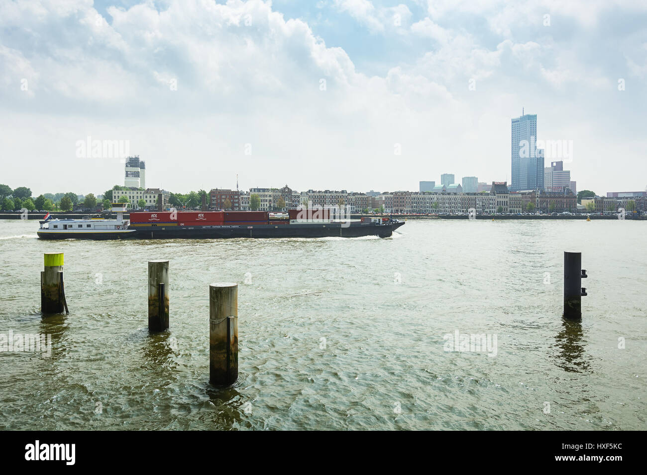 Rotterdam, Netherlands – May 26, 2016: Container ship passes the Nieuwe Maas river in Rotterdam Stock Photo