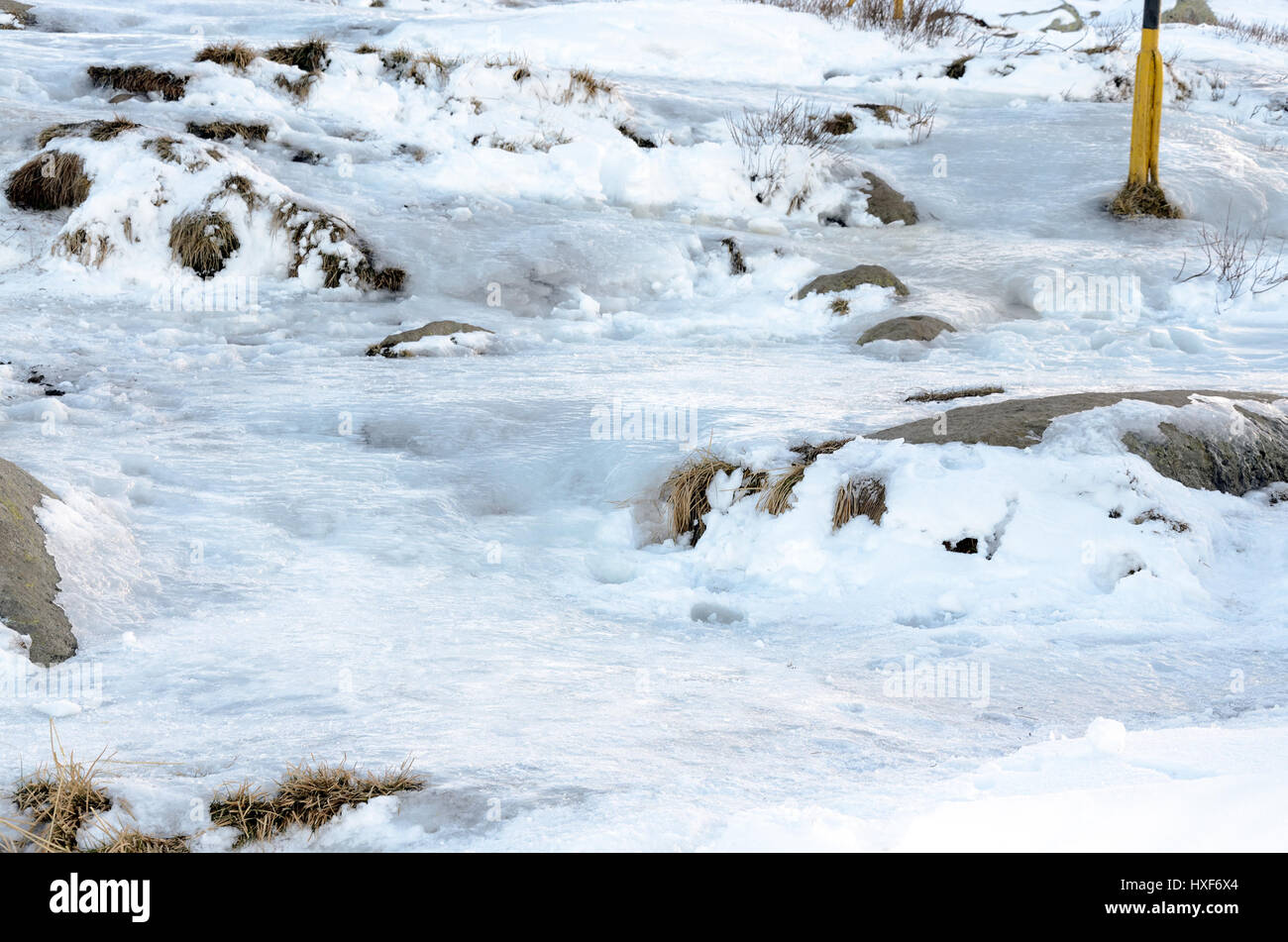 Frozen path in the mountains - Stock Image