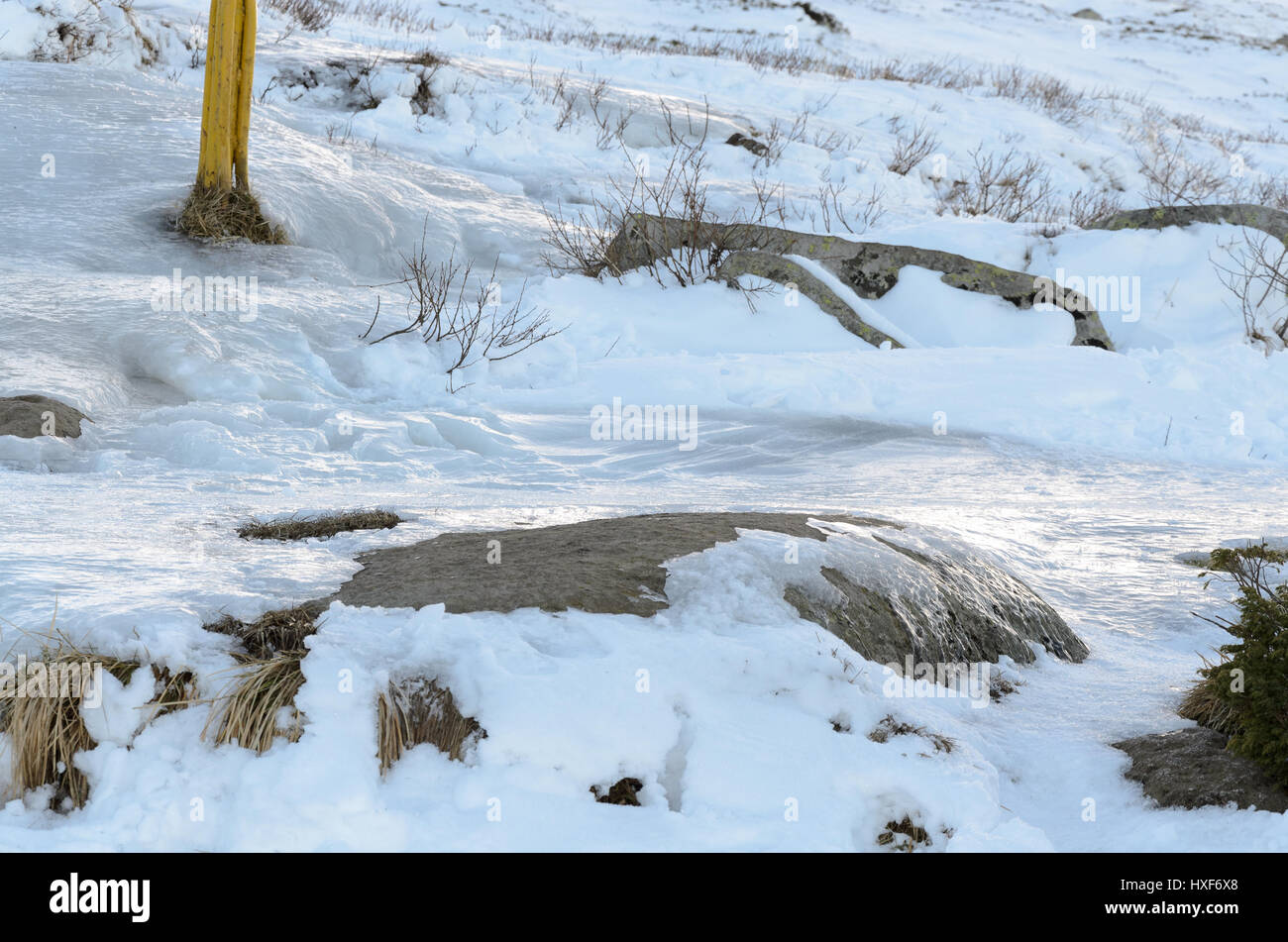 Frozen tourist path in the mountain - Stock Image