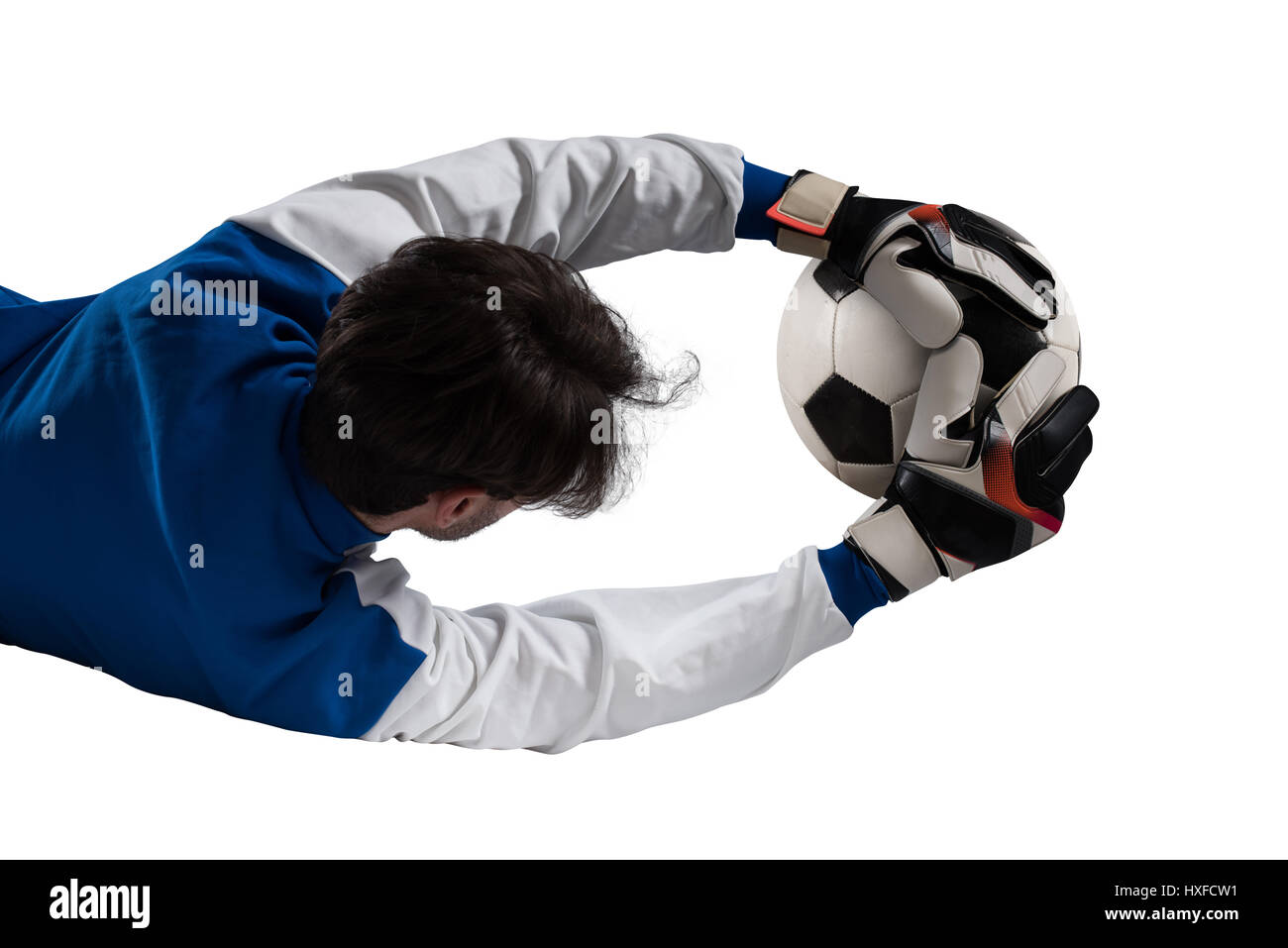 Goalkeeper catches the ball - Stock Image