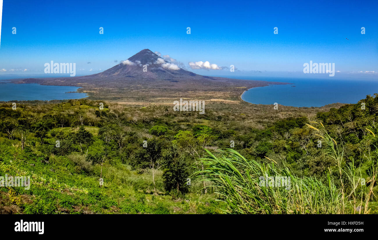 Vista or view from part way up Volcan Maderas, over the isthmus  towards Volcan Concepcion, Isla Ometepe, Nicaragua - Stock Image