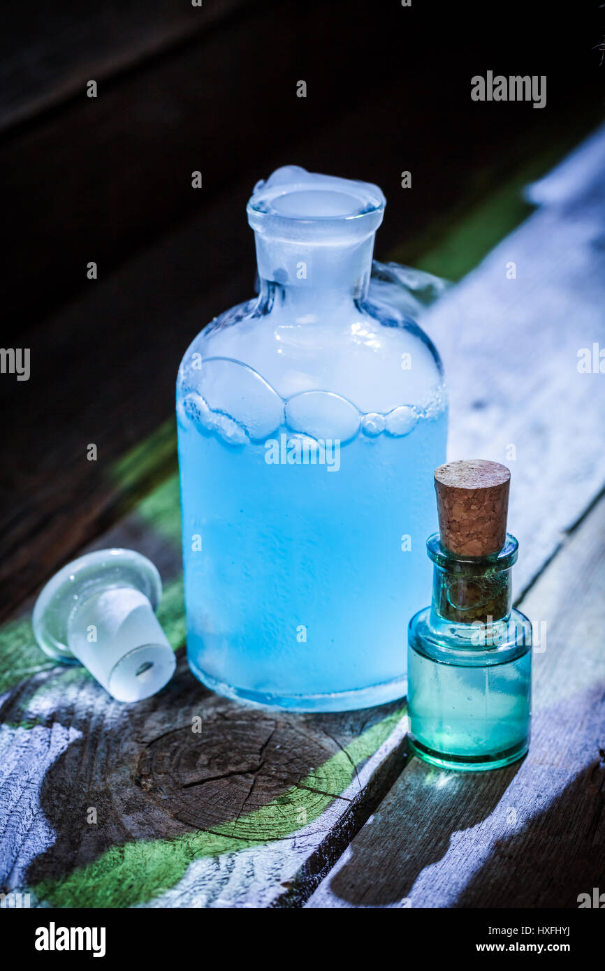 Magical blue potions in witch cottage for Halloween Stock