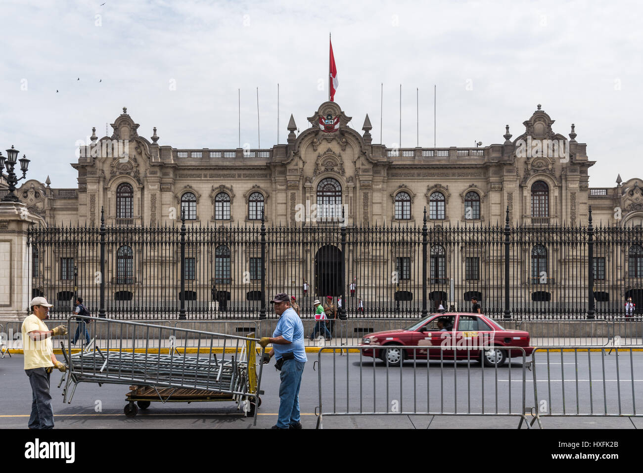 Working crew setting up barricades in front of the Government Palace in anticipate a demonstration. Lima, Peru. - Stock Image
