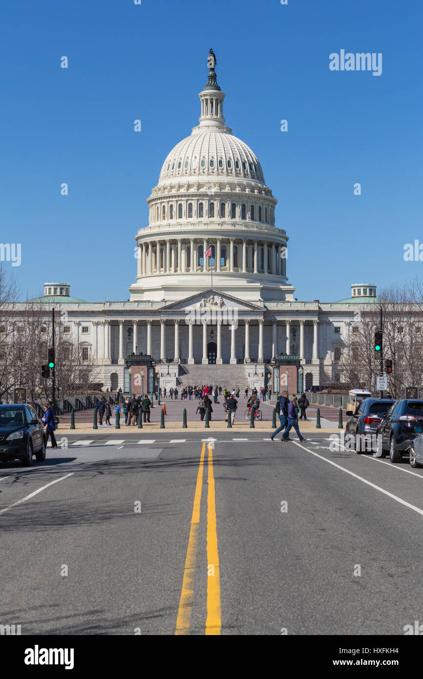 Tourists and visitors at the front of the U.S. Capitol Building in Washington, DC. - Stock Image