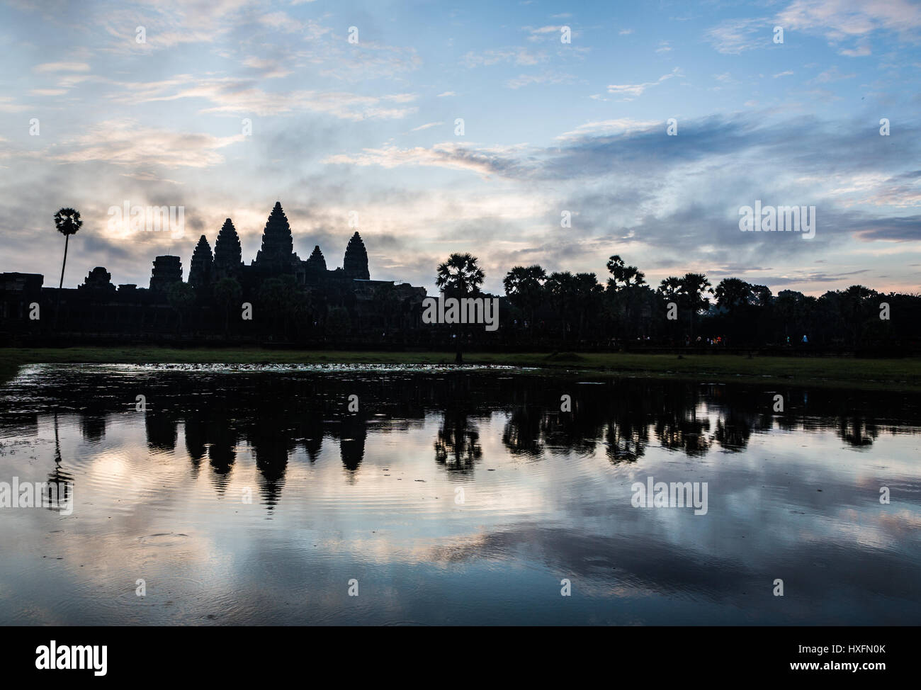 Stunning sunrise over Angkor Wat, as a silhouete, with the temple refleciting in water in Siem Reap, Cambodia. This - Stock Image