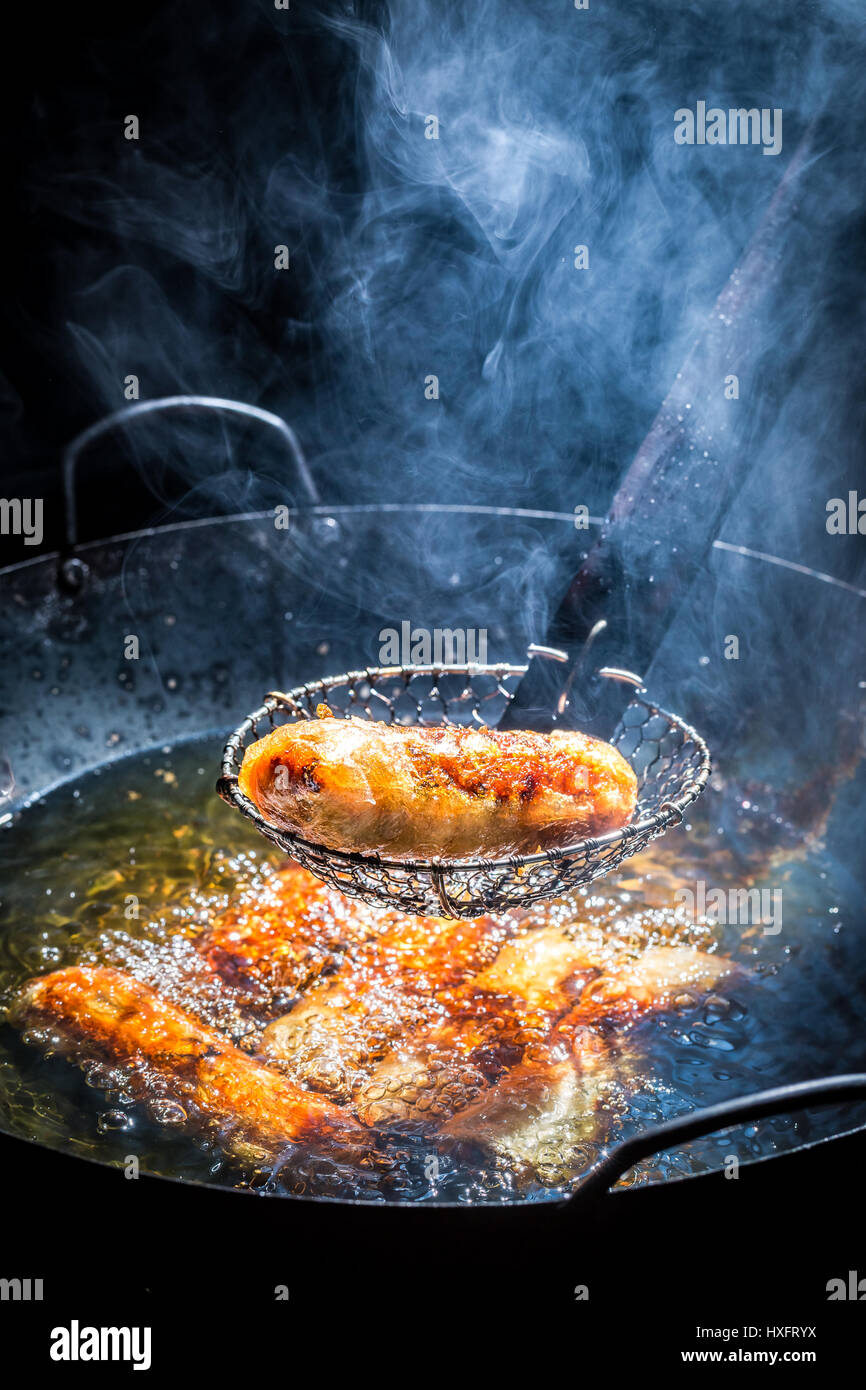 Fresh spring rolls frying in hot oil Stock Photo: 136801726 - Alamy