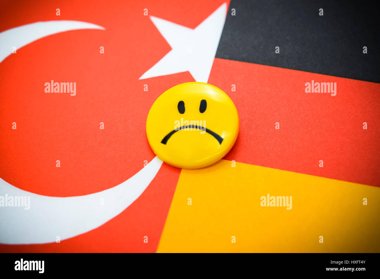 Flags of Germany and Turkey with Schlechter-Laune-Smiley, crisis in the German Turkish relations, Fahnen von Deutschland Stock Photo